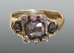18ky gold ring with rose cut diamonds and round brilliant diamonds.